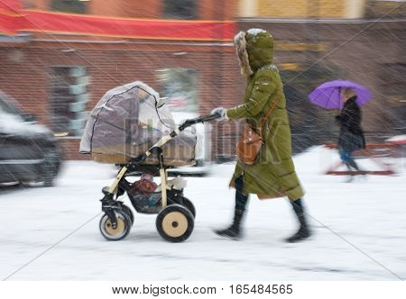 Mother With Small Child In The Stroller