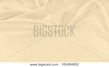 Smooth Elegant Golden Silk Or Satin Luxury Cloth Texture As Wedding Background. Sepia Toned. Retro S