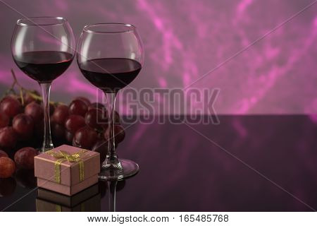 Valentine's Day with a glass of red wine grapes gift