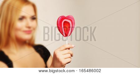 Beautiful happy woman with red heart (concept)