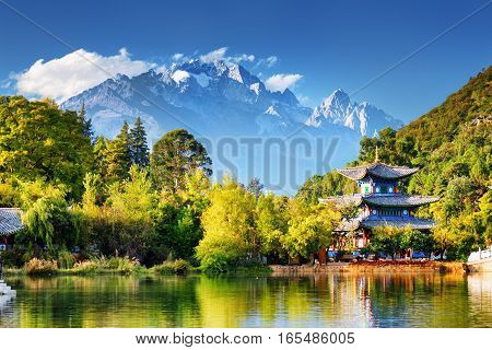 The Jade Dragon Snow Mountain And The Moon Embracing Pavilion