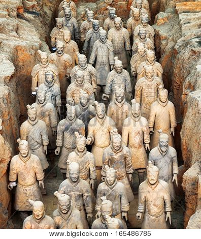 XI'AN SHAANXI PROVINCE CHINA - OCTOBER 28 2015: Terracotta infantrymen of the famous Terracotta Army inside the Qin Shi Huang Mausoleum of the First Emperor of China.