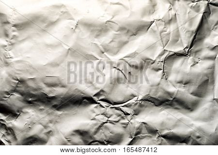 Thin Sheet Of Silver Leaf Background With Shiny Uneven Surface
