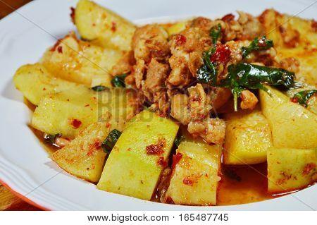 spicy stir fried winter melon with chop pork on dish