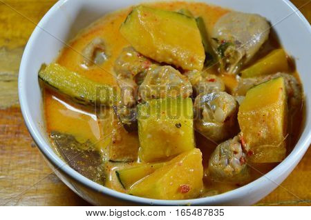 spicy pumpkin with chicken knees in coconut cream curry on bowl