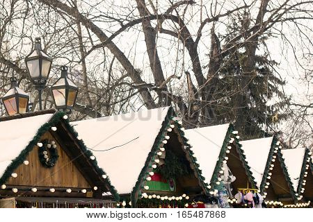 Roofs of wooden houses for selling souvenirs at Christmas Fair