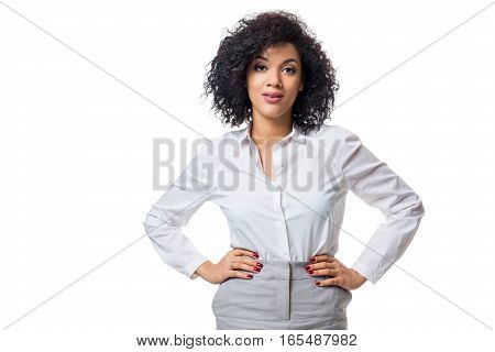 Young beautiful African American woman in studio. Isolated on white background
