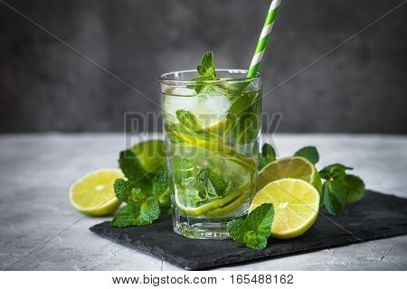Tradition Summer drink mojito with lime mint and ice.