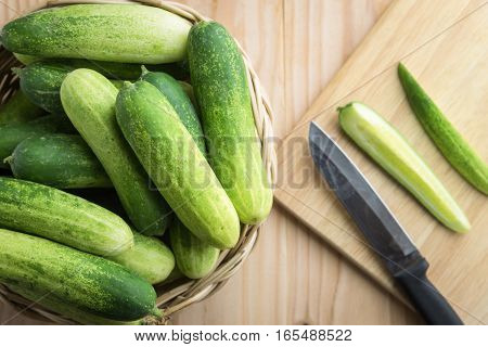 Fresh Cucumber And Slices On Wooden Table..