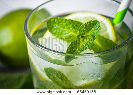 Tradition Summer drink mojito with lime mint and ice. Closeup.