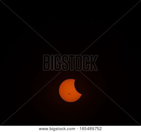 The very beginning of a solar eclips in October 2014 at 5:38 PM.