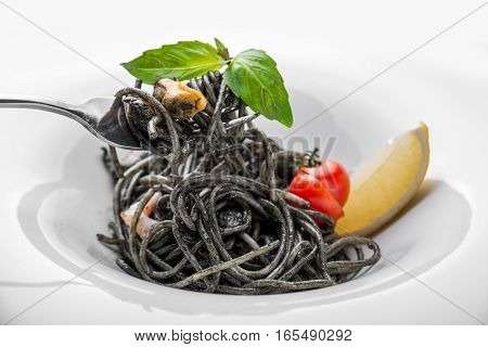 Dish painted black cuttlefish ink spaghetti with seafood