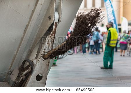 Municipal Dustman Worker with Cleaning Tools in Public Streets