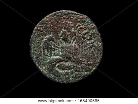 Ancient Roman Bronze Coin Isolated On Black