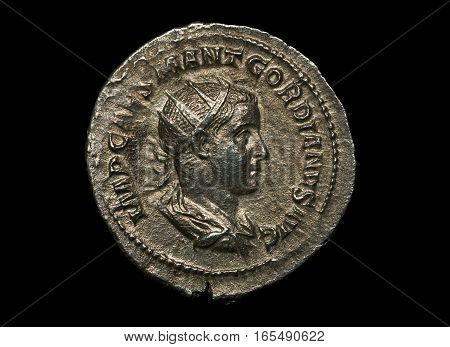 Ancient Roman Silver Coin Of Emperor Gordianus Isolated On Black