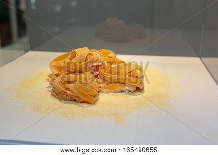 Tagliatelle Italian Pasta On White Table With Flour