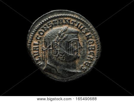 Ancient Roman Copper Coin Of Emperor Constantius Isolated On Black