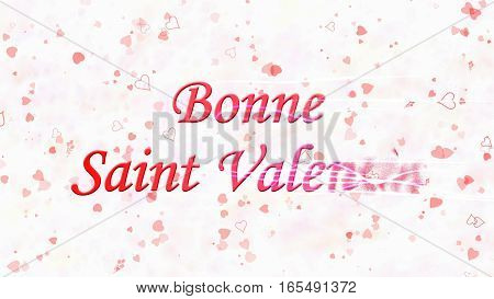 "Happy Valentine's Day Text In French ""bonne Saint Valentin"" Turns To Dust From Right On Light Backgr"