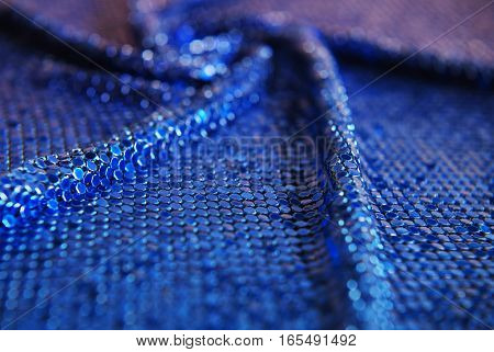 Chainlink fabric blue - shiny texture, depth of field