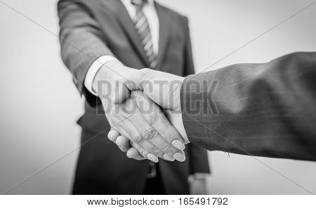 black and white. Business Man. Business handshake and business people. Business handshake. Business handshake and business people concept. Two business men shaking hands over sunny office background. business Partnership, Deal.