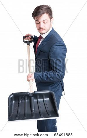 Man Wearing Suit Working With A Snow Shovel