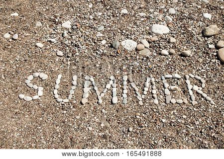 Word Summer Laid Out By Pebble At Beach.