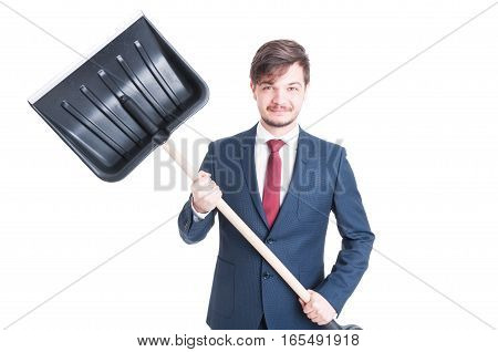 Man Wearing Suit Smiling And Showing A Snow Shovel