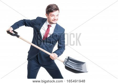 Man Wearing Suit Holding Snow Shovel Looking Happy