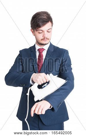 Man Wearing Suit Holding And Ironing His Jacket