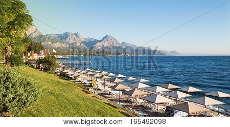 Sunshades And Chaise Lounges On Beach. Turkey, Kemer.