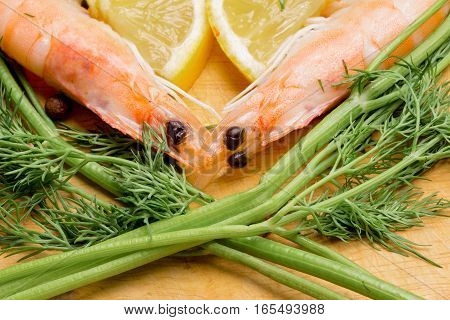 the heart symbol of shrimp, parsley, lemon and spices for cooking a romantic dinner