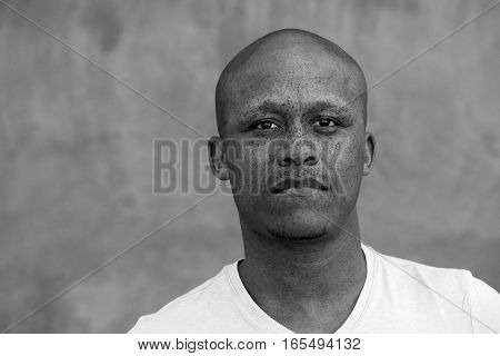 Mixed Race Man With Freckles Staring