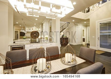 Lovely Dining Space With Rectangular Table And Grey Chairs