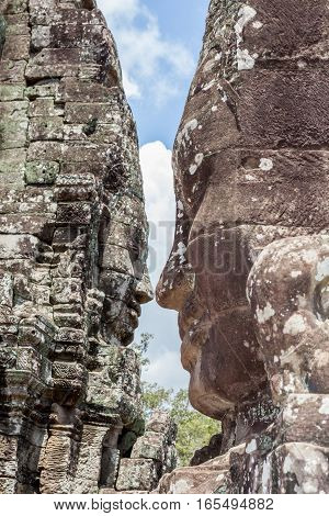 The UNESCO world heritage and landmark Bayon stone faces tower in Angkor Wat Siem Reap Cambodia.