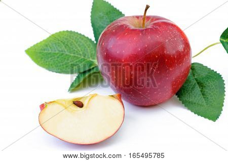 red apple with leaves and section isolated on white background