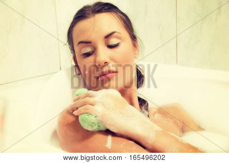 Young Beautiful Naked Red-haired Woman Takes Bubble Bath