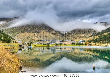 Lake in vall de Nuria under a cloudy sky