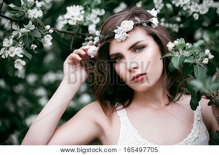 Young Beauty Outdoors. Cute Woman Fashion Model in Flowers Wreath