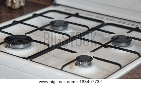 The clean and neat white gas stove