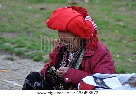 Red Dao Woman With A Red Turban. Sa Pa, Northern Vietnam