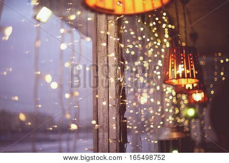 The window is decorated with Christmas garlands