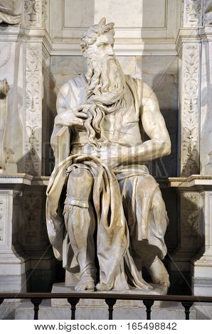 ROME ITALY - MARCH 16 2016: The statue of Moses sculpted by Michelangelo is visited daily by crowd of tourists in the San Pietro in Vincoli church