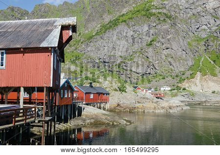 Red rorbu traditional fishing huts in the small fishing village of A Moskenes Lofoten Islands Norway Europe