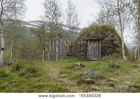 Sami culture: a a turf hut (darfegoahti) in a Sami Camp in Abisko National Park