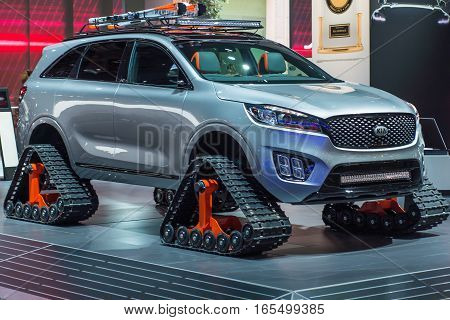 DETROIT MI/USA - JANUARY 12 2017: Caterpillar tracks replace wheels on the Kia Sorento Ski Gondola Concept SUV at the North American International Auto Show (NAIAS).