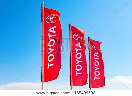 SAMARA RUSSIA - MAY 29 2016: Official dealership flags of Toyota against the blue sky. Toyota Motor Corporation is a Japanese automotive manufacturer