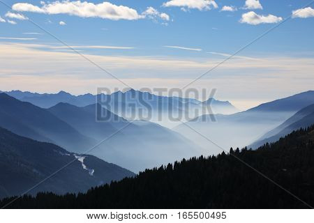 Foggy mountains in winter Dolomite Alps in Madonna di Campiglio (Five Lakes place). Italy