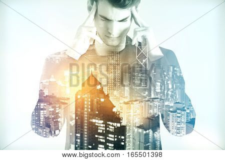 Businessman thinking against a city panorama. Mock up. Double exposure