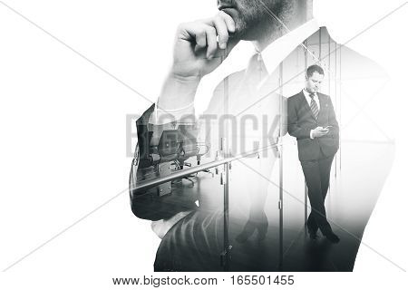 Thoughtful businessperson using cellphone in modern office. Communication concept. Double exposure