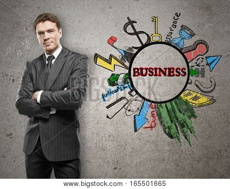 Young businessman thinking and drawing business sketch on concrete wall